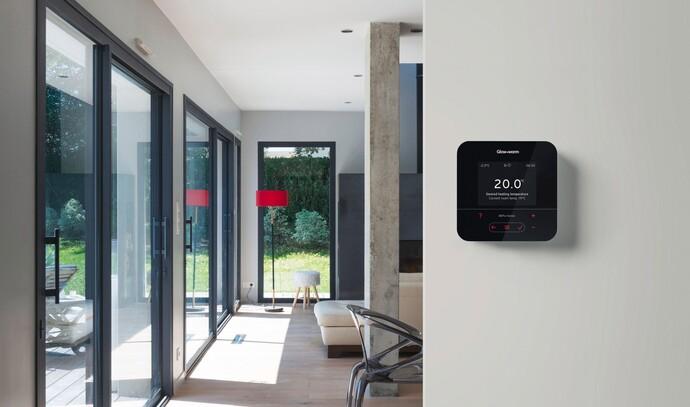MiPro Sense heating control on a kitchen wall