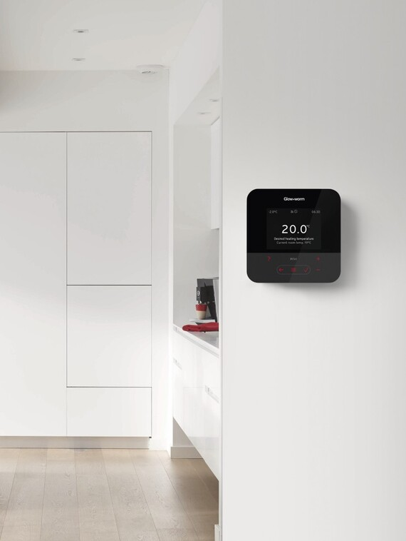Glow-worm's MiSet control mounted to a wall in a modern kitchen